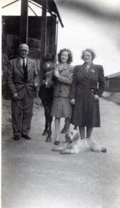 Violet with her husband and daughter and dog, Scruffy in 1946