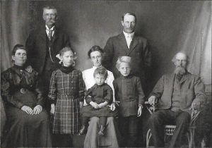Cora (seated, center) with her family in about 1918