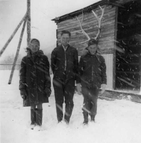 Probably 1948 or 1949 at Pekisko Cabin. Ruby, Boyd, and Archie.